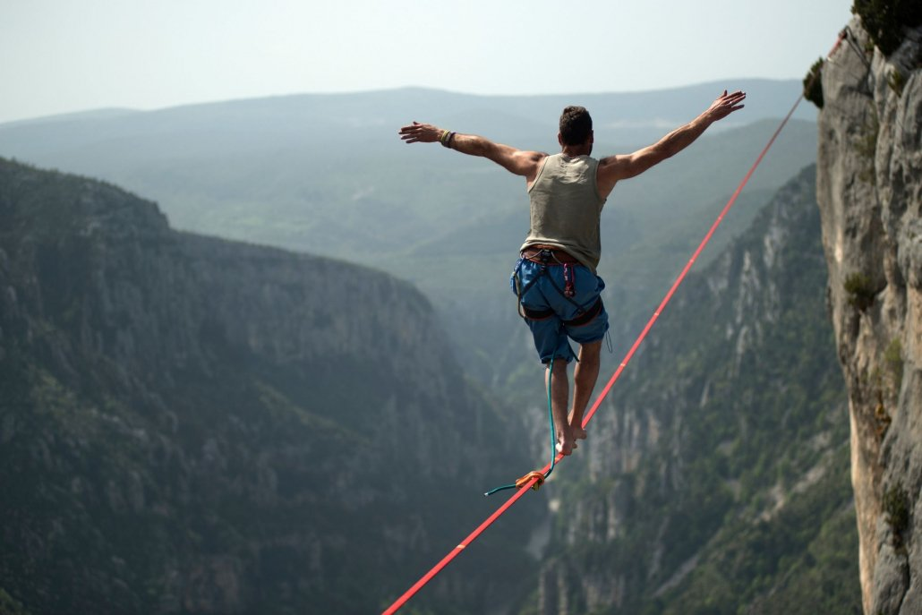 Person balancing on tightrope