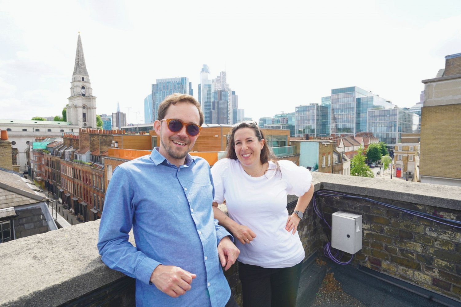 Frances and Simon standing on the rooftop