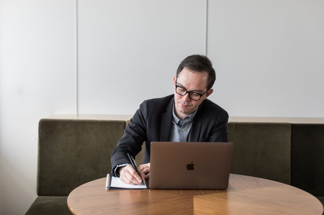Simon working on laptop