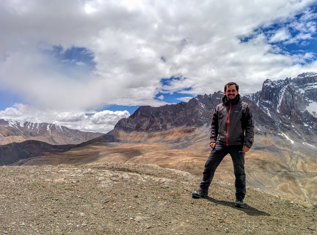 Simon Batchelar standing on the top of a mountain in the Himalayas